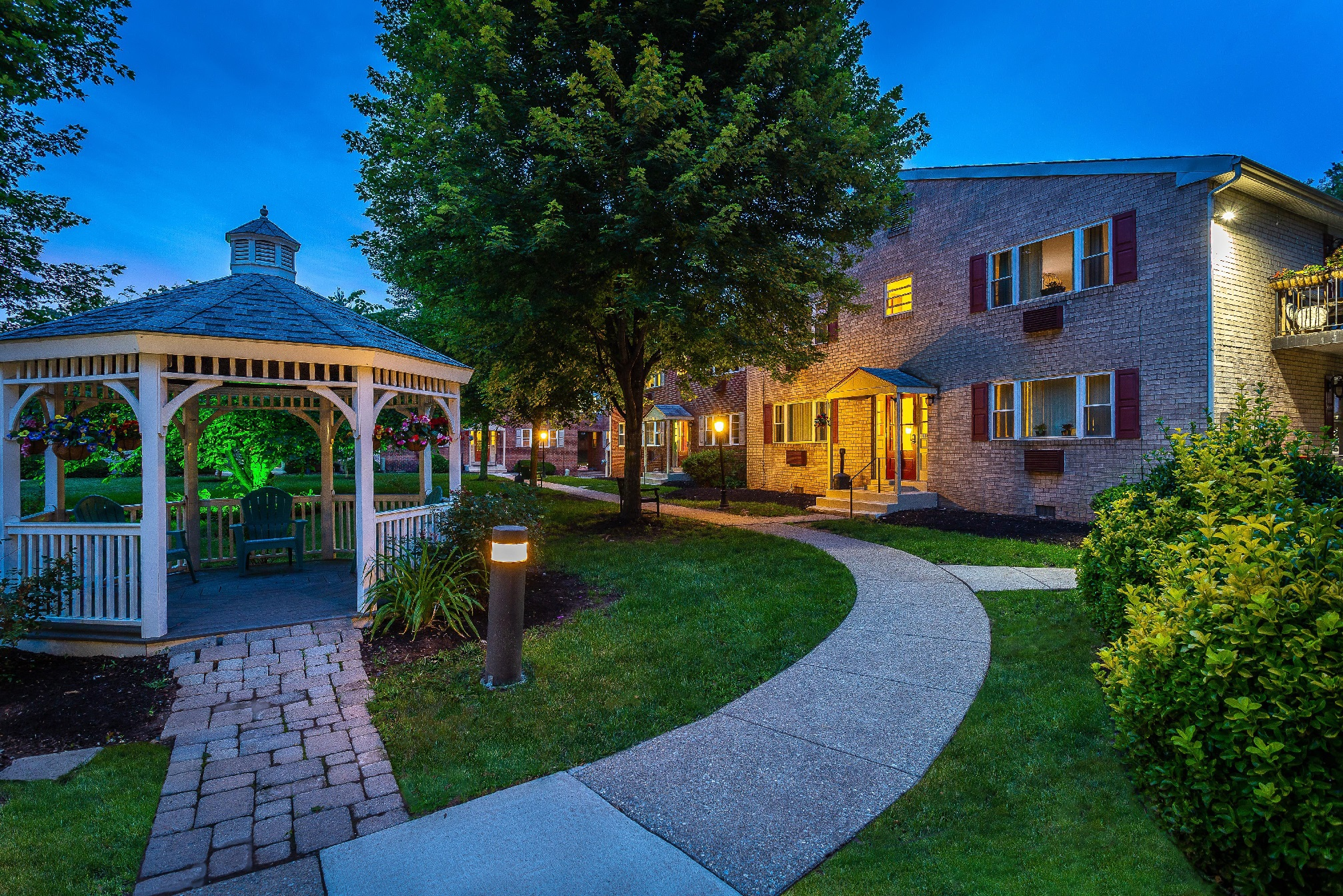 Gazebo and walkway to residential buildings at Westgate Arms apartments for rent in Jeffersonville, PA