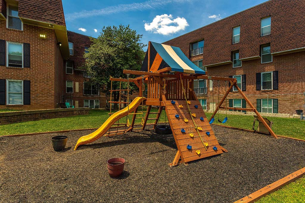 Playground with a yellow slide near 7400 Roosevelt apartments for rent in Northeast Philadelphia