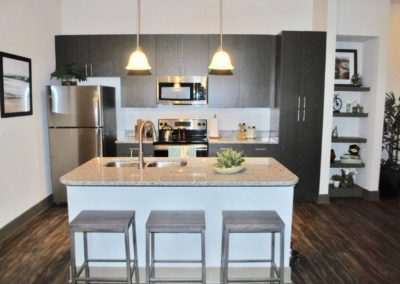 Kitchen with seating area at Addison at Tampa Oaks apartments for rent