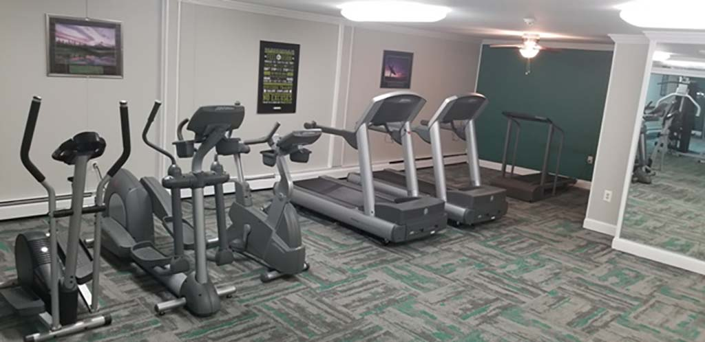 A gym with exercise equipment at Bromley House apartments for rent