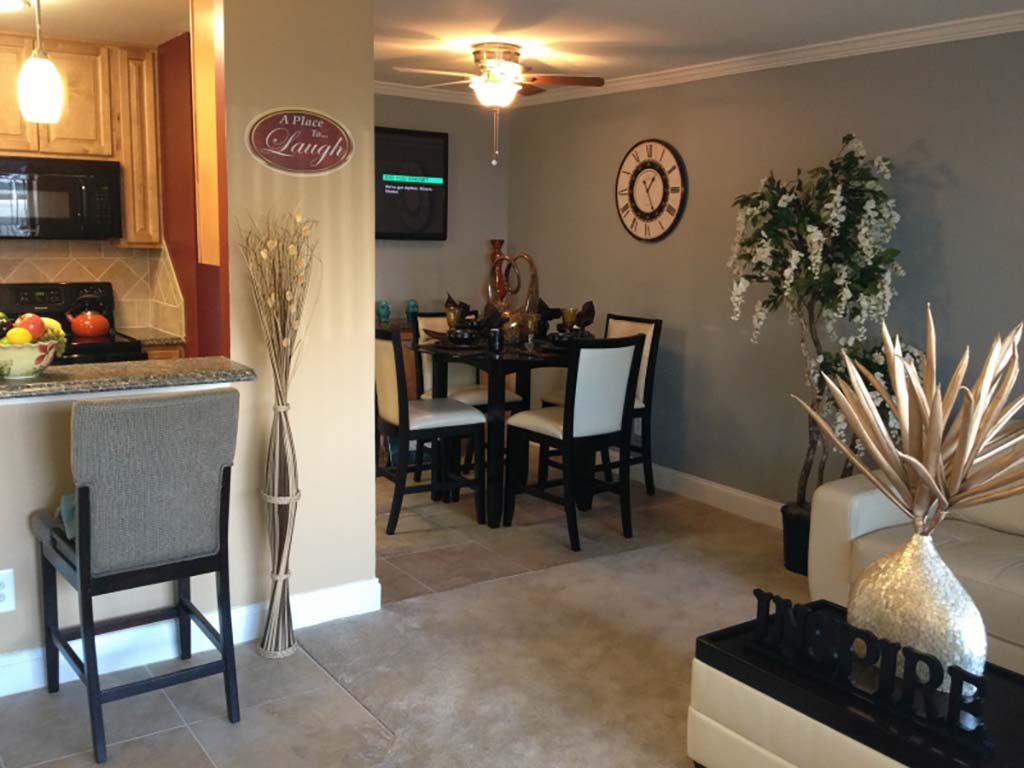 Decorated and fully furnished dining area and kitchen at Haverford Court apartments for rent