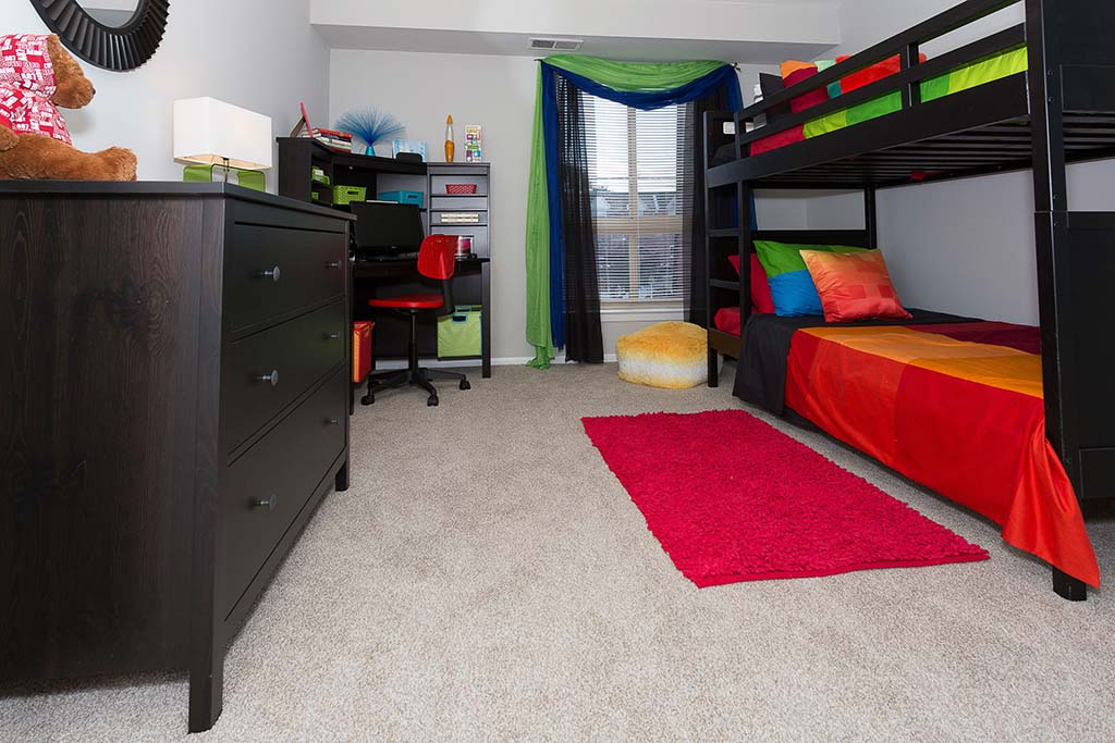 Fully furnished bedroom with bunk beds at Joshua House apartments for rent in Philadelphia, PA