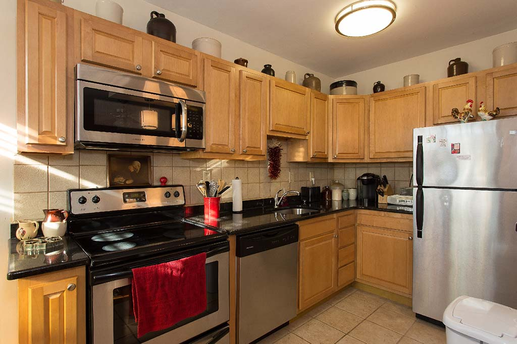 Kitchen with stainless steel appliances at Sedgwick Gardens apartments for rent in Philadelphia, PA