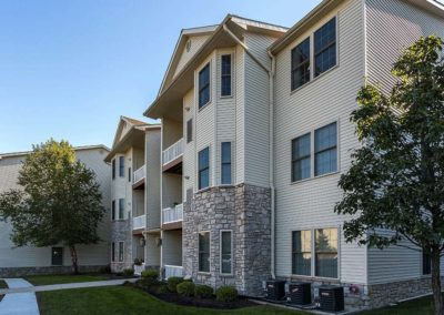Exterior view of residential buildings at The Enclaves at Packer Park apartments for rent