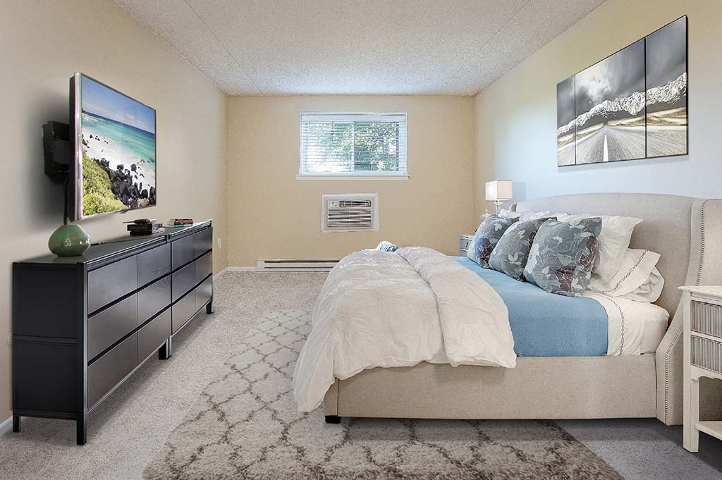 Decorated and fully furnished bedroom with a TV at The Park at Westminster apartments for rent