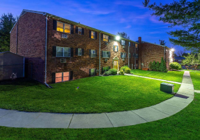 Walkway to residential buildings at Warrington Crossings apartments for rent in Warrington, PA
