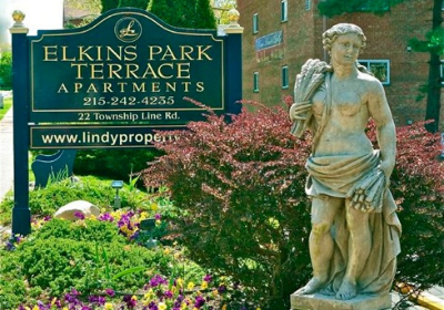 Statue at the entrance sign to Elkins Park Terrace apartments for rent in Elkins Park, PA