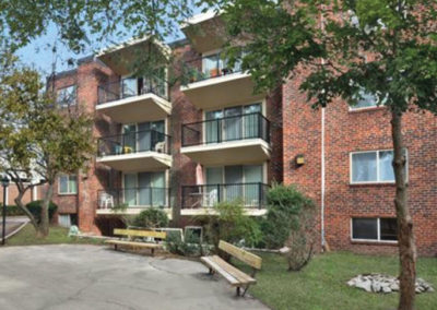 Exterior view of residential buildings at Haverford Court apartments for rent