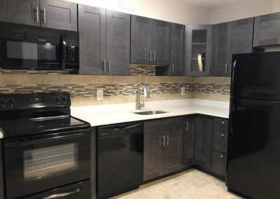 Kitchen with black appliances at The Park at Westminster apartments for rent in Warrington, PA