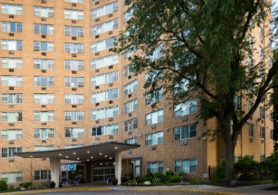 Exterior view of brick residential buildings at Yono apartments for rent in Philadelphia, PA