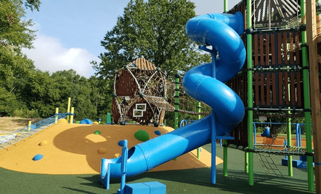 Playground with a blue slide at Lions Pride Park in Warrington, PA