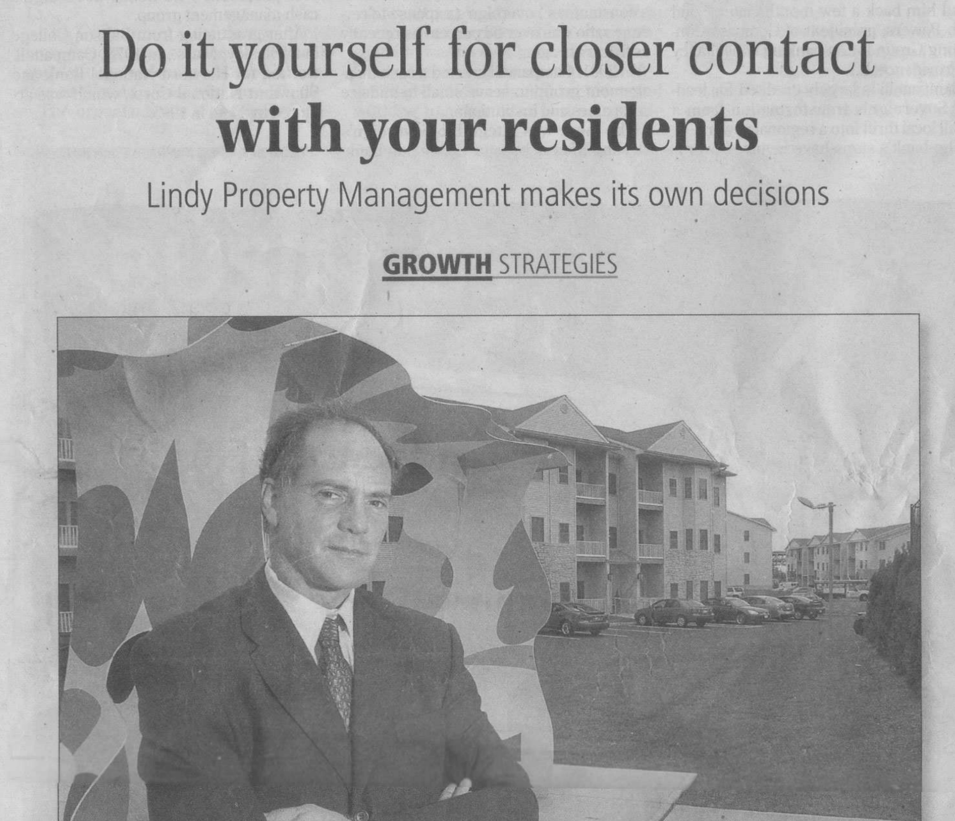Newspaper article about Lindy Property Management with a man on the front cover near an apartment building for rent
