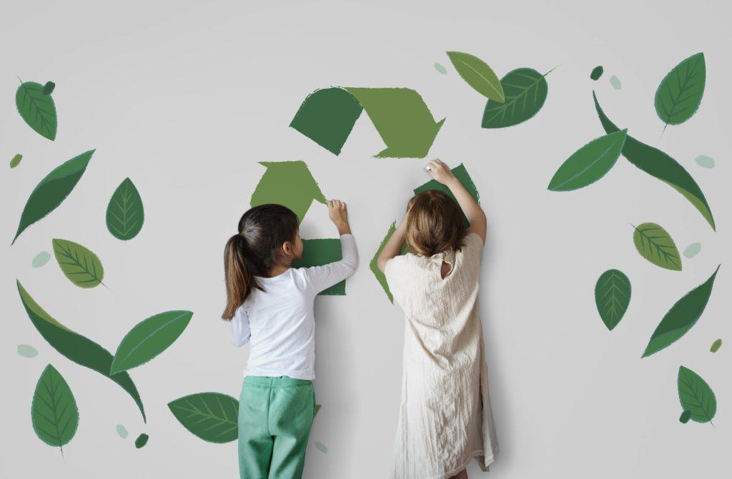 Girl painting recyling symbol-shutterstock_581322184-min