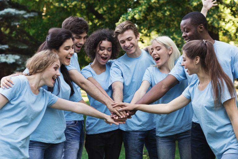 Group of Volunteers hands in-shutterstock_1190457109-min