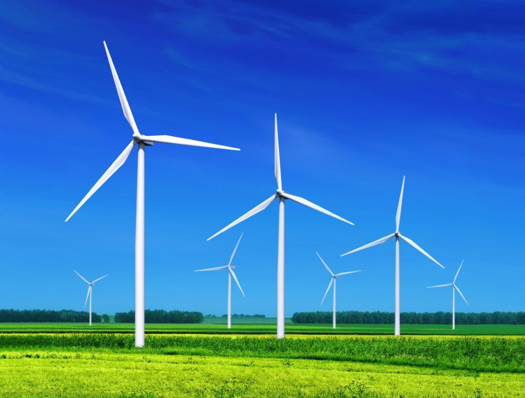 Wind Turbines on grassy field-shutterstock_78314113-min