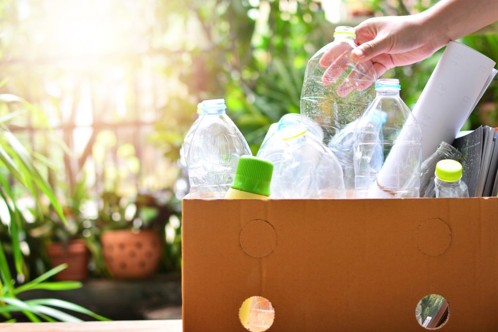 box of recyling and hand- shutterstock_698172910-min