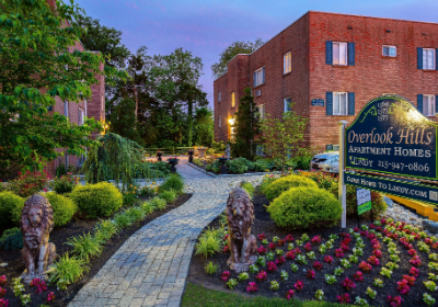 Entrance to Overlook apartments for rent surrounded by flowers in Abington, PA