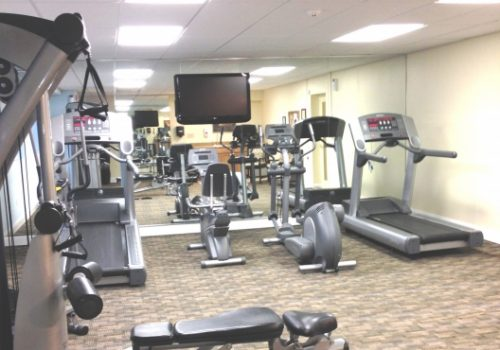 A fully equipped gym at Crossings at Stanbridge apartments for rent
