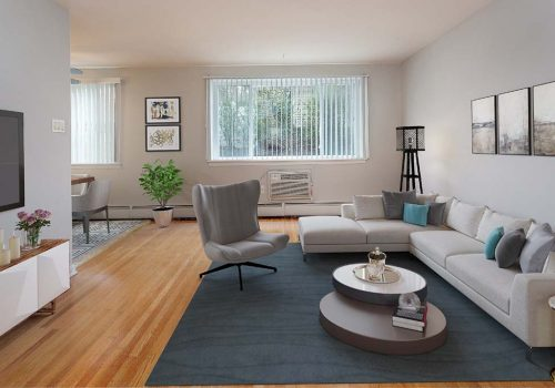Living room with a couch, chair, and TV at Eola Park apartments for rent in Philadelphia, PA