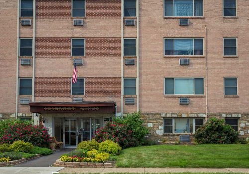 Exterior view of residential buildings at Longwood Manor apartments for rent in Philadelphia, PA