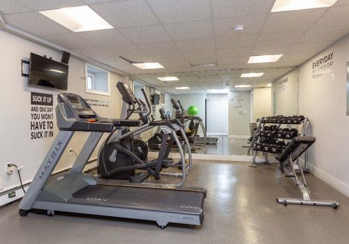 Fitness center with exercise equipment at Mt Airy Place apartments for rent in Philadelphia, PA