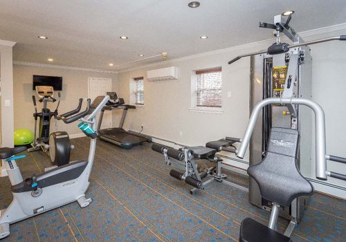 Fitness center with exercise equipment at Rosedale Court apartments for rent in Abington, PA