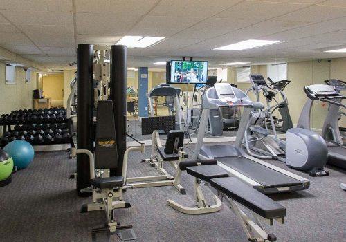 Fitness center with exercise equipment at Sedgwick Gardens apartments for rent in Philadelphia, PA