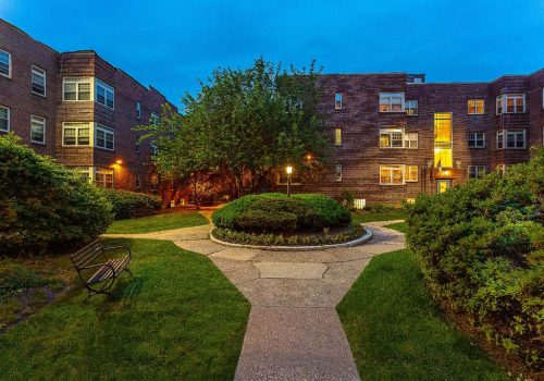 Beautifully landscaped courtyard at Sedgwick Gardens apartments for rent in Philadelphia, PA