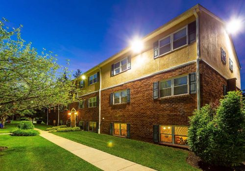 Exterior view of residential buildings at Warrington Crossings apartments for rent