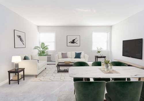 Large living room with two couches and a TV with a view of the dining area at Warrington Crossings at Warrington, PA