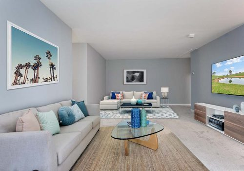 Large living room with two couches and a TV at Warrington Crossings apartments for rent