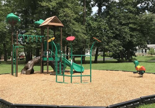 Playground with a green slide near Warrington Crossings apartments for rent in Warrington, PA