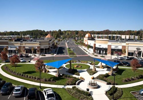 Exterior view of a shopping center nearby Warrington Crossings apartments for rent in Warrington, PA