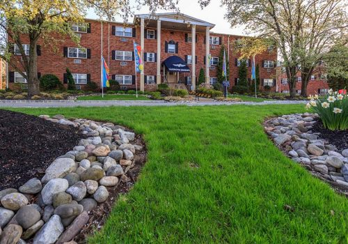 Entrance to Warrington Crossings apartments for rent with beautifully landscaped grounds
