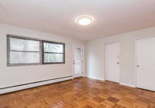 Open concept living/dining room with ample closet and storage space and hardwood floors at Sedgwick Terrace apartments for rent