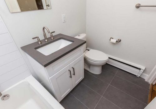 Updated bathroom with subway tiling at Sedgwick Terrace apartments for rent in West Mt. Airy, Philadelphia, PA