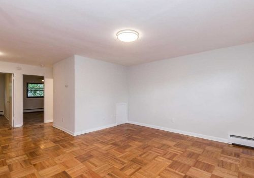 Open concept living/dining room with hardwood floors at Sedgwick Terrace apartments for rent in West Mt. Airy, Philadelphia, PA