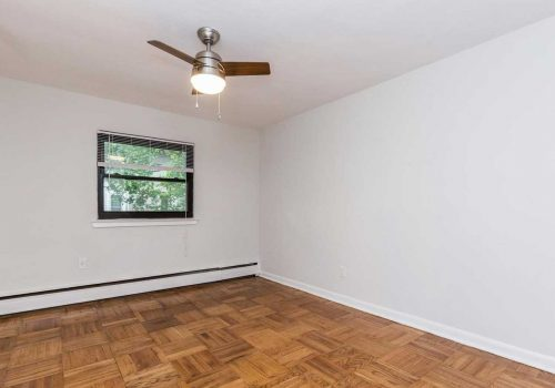 Bedroom with hardwood floors and ample lighting at Sedgwick Terrace apartments for rent in West Mt. Airy, Philadelphia, PA